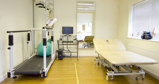 Interior shot of Manchester OT clinic with treadmill and patient beds.