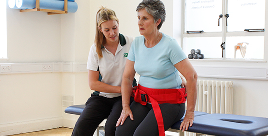 ManchesterOT therapist uses physical aid to help improve patients condition.